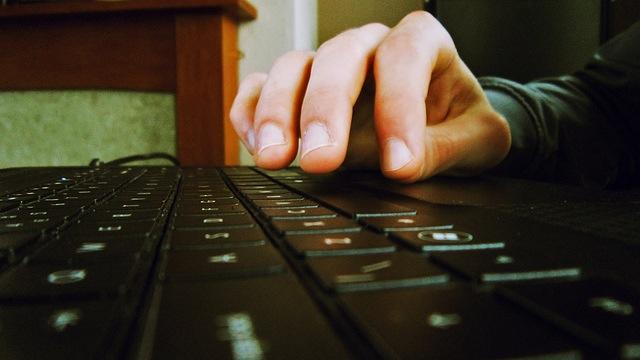 fingers typing keyboard