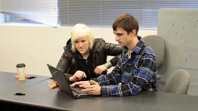 pair at laptop