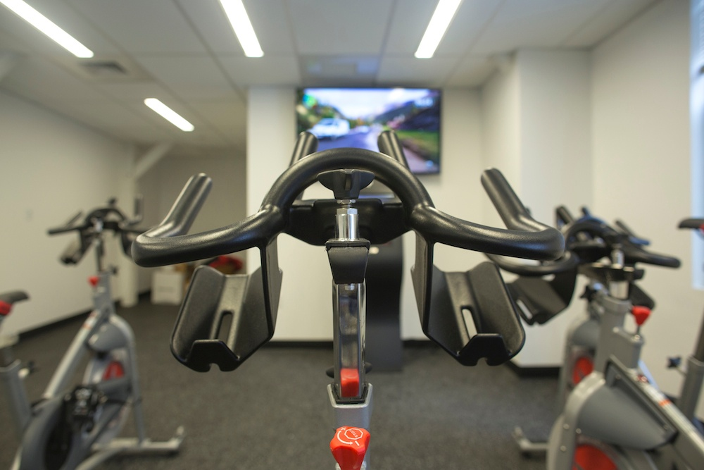 Picture of Hubspot's workplace gym, which emphasizes employee health and wellness.
