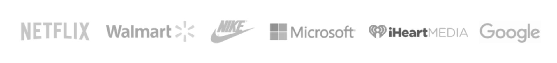 Una captura de pantalla de los logotipos de los clientes existentes de Envato en el sitio web de Envato.