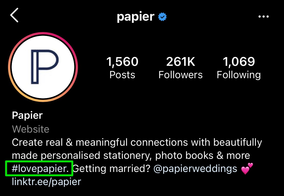 papier bio showing their branded hashtag mention